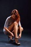 Pretty woman dressing high heels Stock Photography