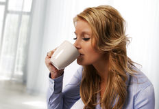 Pretty woman drinking Stock Image