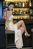 Pretty woman drinking in a bar Royalty Free Stock Photos