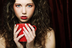 Pretty woman drinking coffee. Young pretty woman drinking coffee Royalty Free Stock Photo