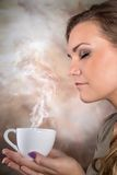 Pretty woman drinking coffee. Pretty woman drinking cup of coffee Stock Image