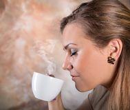 Pretty woman drinking coffee. Pretty woman drinking cup of coffee Stock Photos