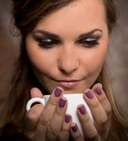 Pretty woman drinking coffee. Pretty woman drinking cup of coffee Stock Images