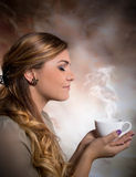 Pretty woman drinking coffee. Pretty woman drinking cup of coffee Stock Photo