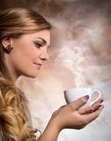 Pretty woman drinking coffee. Pretty woman drinking cup of coffee Royalty Free Stock Images