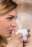 Pretty woman drinking coffee. Pretty woman drinking cup of coffee Stock Photography