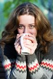 Pretty woman drinking a coffee outdoors Royalty Free Stock Image
