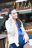 Pretty woman drinking coffee in the street Stock Photo