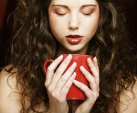 Pretty woman drinking coffee. Young pretty woman drinking coffee Stock Images