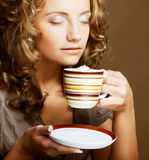 Pretty woman drinking coffee. Young pretty woman drinking coffee Royalty Free Stock Image