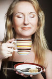 Pretty woman drinking coffee. Young pretty woman drinking coffee Stock Photos