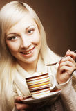 Pretty woman drinking coffee. Young pretty woman drinking coffee Royalty Free Stock Photography