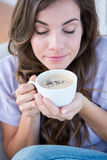 Pretty woman drinking cup of coffee. At home in the living room Royalty Free Stock Photo