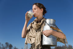 Pretty woman is drinking fresh milk Stock Images