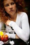 Pretty woman drinking fruit tea Stock Photos