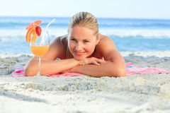 Pretty woman drinking her cocktail Royalty Free Stock Photography