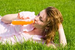 Pretty woman drinking juice Stock Photo