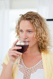 Pretty woman drinking some wine Royalty Free Stock Photography