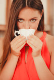 Pretty woman drinking tea or coffee at home. Gorgeous young girl with hot beverage relaxing in kitchen Royalty Free Stock Photos