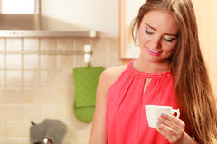 Pretty woman drinking tea or coffee at home. Royalty Free Stock Images