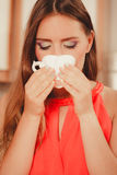 Pretty woman drinking tea or coffee at home. Gorgeous young girl with hot beverage relaxing in kitchen Stock Photo