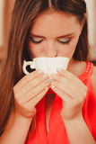 Pretty woman drinking tea or coffee at home. Royalty Free Stock Photos