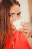 Pretty woman drinking tea or coffee at home. Gorgeous young girl with hot beverage relaxing in kitchen Stock Photos