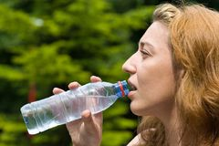 Pretty Woman Drinking Water Royalty Free Stock Images