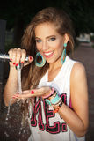 Pretty woman drinking water in the park Stock Images