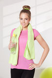 Pretty woman drinking water after workout Royalty Free Stock Photo