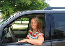Pretty Woman Driver. A beautiful young woman driving a car, could be a soccer mom, or great auto insurance pic Stock Photo