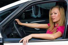 Pretty woman - driver. Woman Sitting In Car Getting Ready To Drive Stock Images