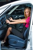 Pretty woman - driver. Woman Sitting In Car Getting Ready To Drive Stock Photos