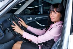 Pretty woman - driver. Woman Sitting In Car Getting Ready To Drive Royalty Free Stock Photography