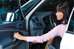 Pretty woman - driver. Woman Sitting In Car Getting Ready To Drive Royalty Free Stock Image