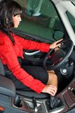 Pretty woman - driver. Woman Sitting In Car Getting Ready To Drive Stock Photo