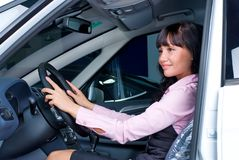 Pretty woman - driver. Woman Sitting In Car Getting Ready To Drive Stock Image