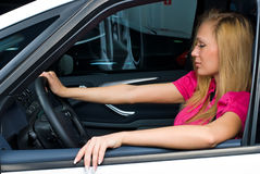 Pretty woman - driver. Woman Sitting In Car Getting Ready To Drive Royalty Free Stock Photos