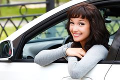 Pretty woman driver smiling to you Stock Photo