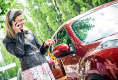 Pretty woman driver. Young woman holding keys to new car and smiling Royalty Free Stock Image