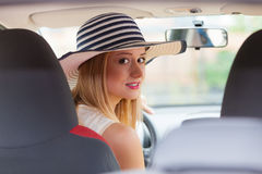 Pretty woman driving her car Stock Photography