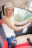 Pretty woman driving her car Stock Image