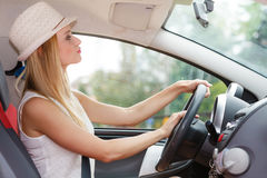 Pretty woman driving her car Stock Images