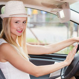 Pretty woman driving her car Stock Photos