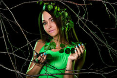 Pretty woman between dry branches Stock Photos