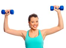 Pretty woman with dumbbells Royalty Free Stock Images