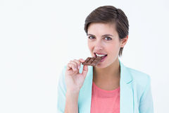 Pretty woman eating bar of chocolate Stock Photo
