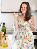 Pretty woman eating biscuit and smiling Royalty Free Stock Image