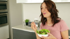 Pretty woman eating a bowl of healthy salad Stock Photography