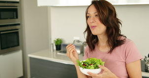 Pretty woman eating a bowl of healthy salad stock footage